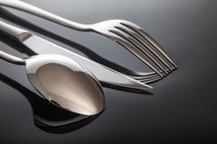 Knife and fork, spoon, on a black background.  Stock Images
