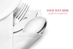 Knife, fork and spoon with linen serviette. Stock Image