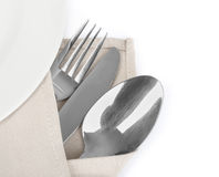 Knife, fork and spoon with linen serviette Royalty Free Stock Photography