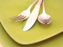 Knife, fork, spoon and plate Stock Photography