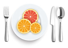 Knife Fork Spoon Plate Citrus Fruits Royalty Free Stock Photography