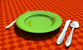 Knife, fork, spoon and plate with table coth Royalty Free Stock Photography