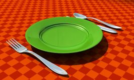 Knife, fork, spoon and plate with table coth Stock Photo