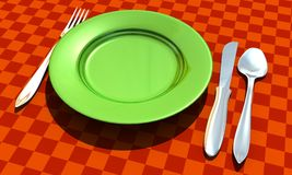 Knife, fork, spoon and plate with table coth Stock Photos