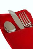 Knife, fork and spoon in a red napkin Stock Image