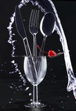 Knife, fork, spoon, and water Royalty Free Stock Photo