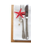Knife and fork with starfish table setting Royalty Free Stock Images