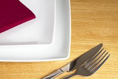 Knife and fork on table Stock Image