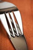 Knife and fork on table Royalty Free Stock Photo