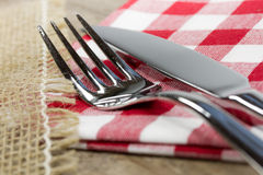 Knife and fork. On table close up royalty free stock photography