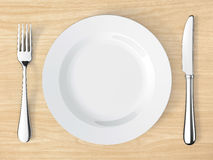 Knife and fork on table Royalty Free Stock Image