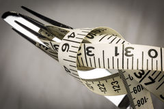 Knife, Fork and Tape Measure Royalty Free Stock Images