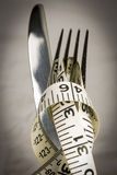 Knife, Fork and Tape Measure Stock Photos