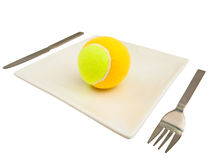Knife,  fork and tennis-ball at plate Stock Images