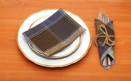 Knife and fork in textile napkin Royalty Free Stock Photography
