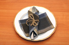 Knife and fork in textile napkin Stock Photography