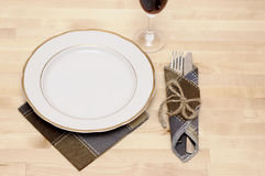 Knife and fork in textile napkin Stock Photo