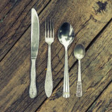 Knife, fork, and two spoons stock images