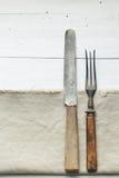 Knife and fork. Vintage knife and fork on a napkin lie Stock Image