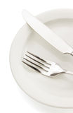 Knife and fork on white Royalty Free Stock Photos