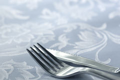 Knife and Fork on White Linen Royalty Free Stock Photos