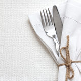 Knife and fork with white linen Royalty Free Stock Images