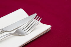 Knife and fork with white napkin Royalty Free Stock Photos