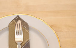 Knife and fork with white plate Stock Images