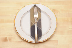 Knife and fork with white plate Stock Photos