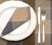 Knife and fork with white plate Royalty Free Stock Photography