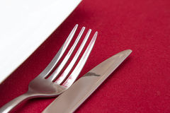 Knife and fork with white plate Royalty Free Stock Image