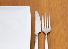 Knife and fork with white plate Royalty Free Stock Photo