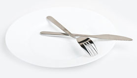 Knife and fork on plate Stock Photo