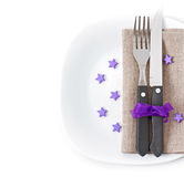 Knife and fork on a white plate Stock Images