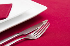 Knife and fork with white plates Stock Photos