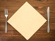 Knife and fork on wood Stock Images