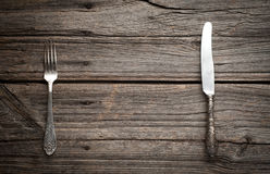 Knife and fork on wooden background. Stock Photography