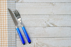 Knife and fork on a wooden background Royalty Free Stock Photo