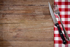 Knife and fork. On wooden table royalty free stock photos