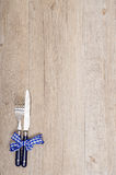 Knife and fork on a wooden table Stock Photography