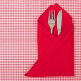 Knife and fork wrapped in a red napkin Stock Photography