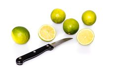 Knife and green fresh limes Stock Photography