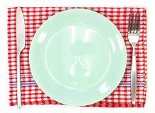Knife, green plate and fork Stock Photo