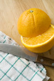 Knife and half of orange. Knife and half pieces of orange cut Royalty Free Stock Image