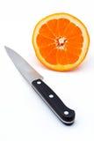 Knife and Half an orange Stock Photo