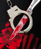 Knife and handcuffs stock image