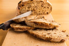 Knife in a Handmade Bread. After cut 4 Bread Slide Royalty Free Stock Photo