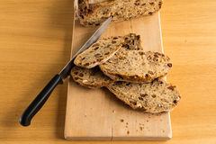 Knife in a Handmade Bread. After cut 4 Bread Slide ready for a healthy Breakfast Royalty Free Stock Photos