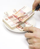 Knife, hands and money stock photo
