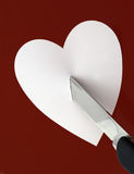 Knife and heart. Brake love concept stock images